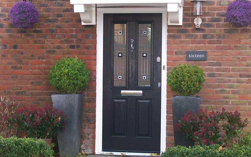 Black composite front door with bespoke glass design